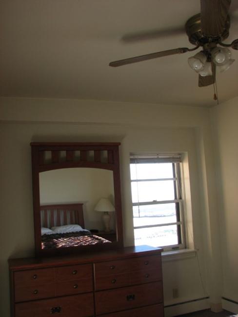 Bedroom with Large Mirror Dresser