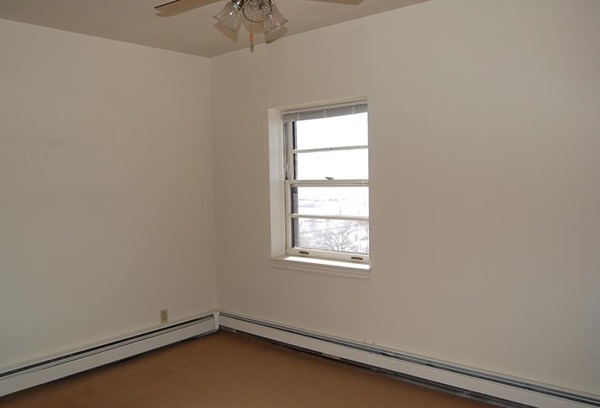 Bedroom with ceiling fan and singular window